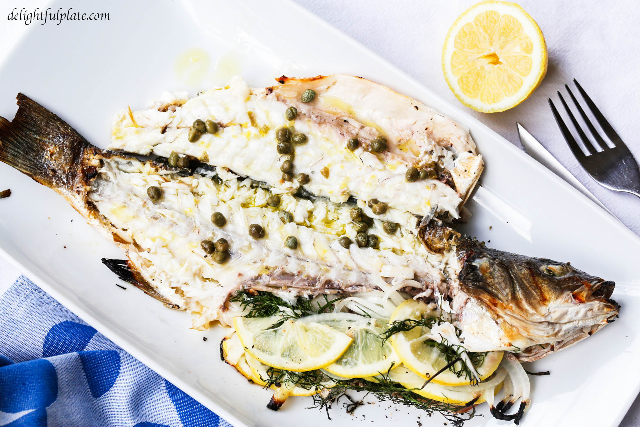 Grilled whole branzino with lemon caper sauce