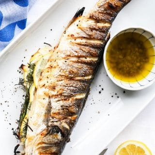 Grilled whole branzino with lemon caper sauce. Find all the tips you need for grilling and serving whole fish.