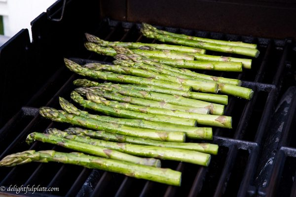 grilled asparagus eaten with grilled opah
