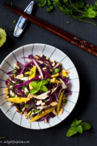 This cabbage-based salad with mango, shredded chicken and herbs is so refreshing and crunchy. It is also easy and quick to put together this salad.