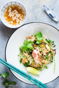 Crab Cellophane Noodles is a traditional Vietnamese dish. The dish is incredibly delicious with the natural sweetness of crab meat, soft translucent noodles, crunchy vegetables, and refreshing lime fish sauce dressing.