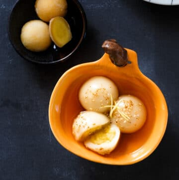 Vietnamese Glutinous Rice Balls (che troi nuoc) are filled with mung bean paste and bathed in a fragrant and sweet ginger syrup. This classic Vietnamese dessert is perfect for cold weather.