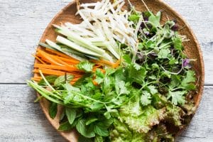 Fresh veggies and herbs for Vietnamese Beef Noodle Salad: lettuce, carrot, cucumber and bean sprouts.