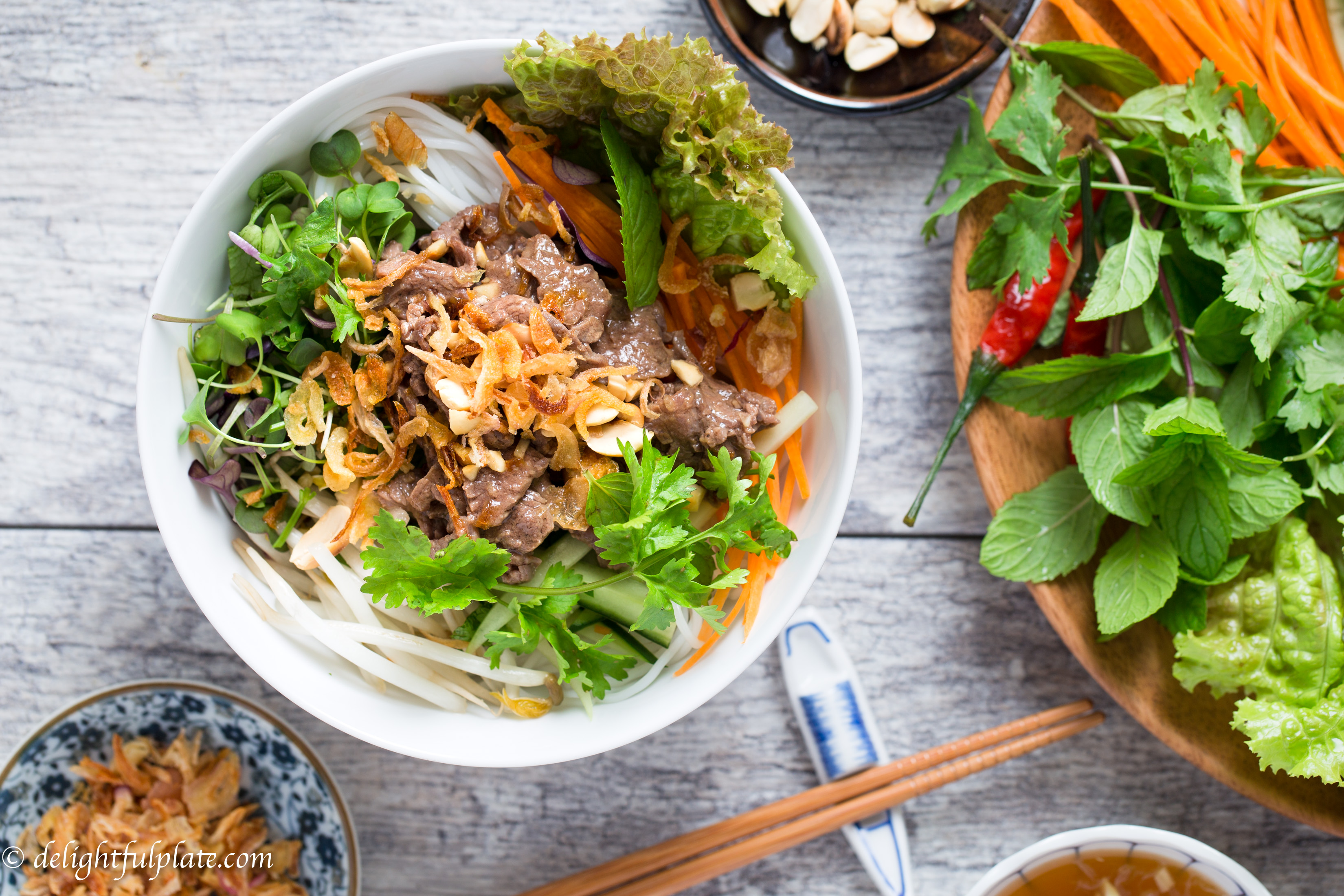 Vietnamese Beef Noodle Salad (Bun Bo Xao) is very tasty with flavorful beef, fresh herbs and veggies. It is quick and easy to make, and can be either a main or side dish.