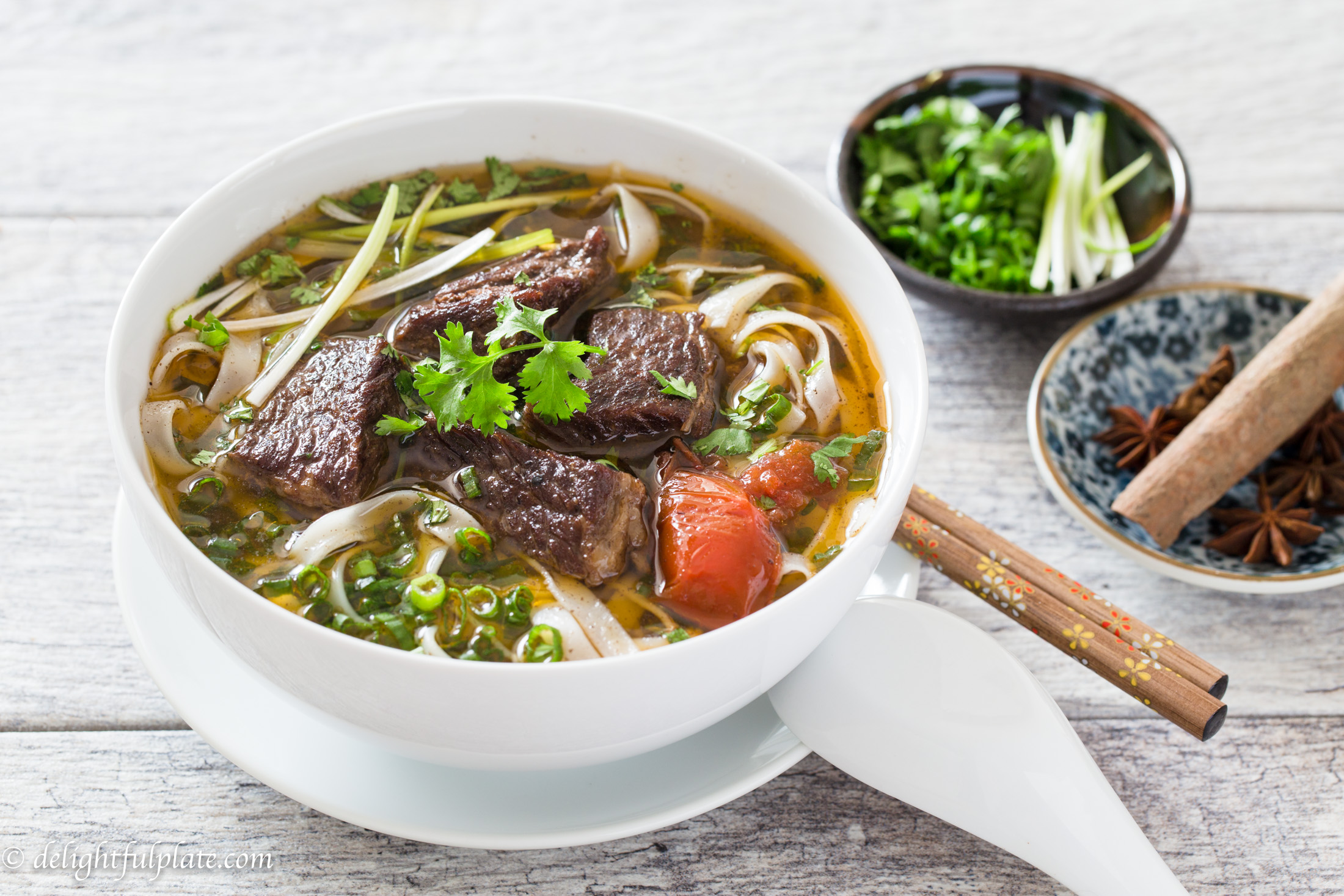 A bowl of hearty and comforting Vietnamese beef stew pho noodle soup