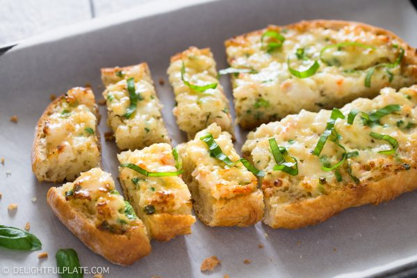 This baked shrimp toast features flavorful shrimp mixture on top of crispy bread. Sprinkle some fresh basil and serve as an appetizer for parties, holidays or any meals.