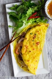 Vietnamese Crepe (Banh Xeo) is thin, crispy and filled with shrimp, pork, and crunchy vegetables. This delicious crepe is quick and easy to make. Serve it with fresh herbs and refreshing dipping sauce as a snack, appetizer or main dish.
