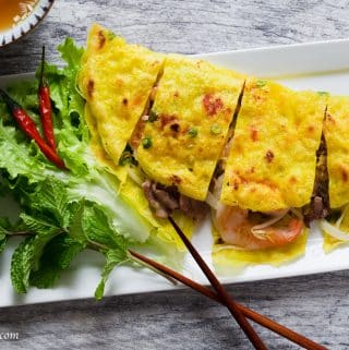 Vietnamese Crepe (Banh Xeo) is crispy, light and filled with shrimp, pork, and crunchy vegetables. Serve it with fresh herbs and refreshing lime fish dipping sauce as a snack, appetizer or main dish.