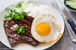 Vietnamese grilled lemongrass pork chops, served with rice and a fried egg. These pork chops are flavorful and easy to make at home.