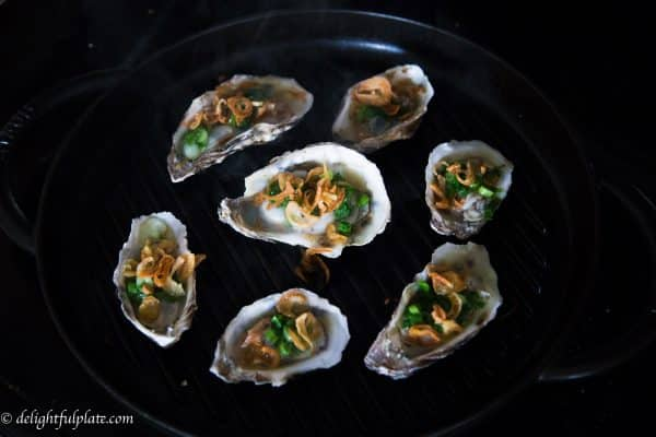 Vietnamese-style grilled oysters with scallion and fried shallot