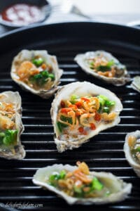 Vietnamese-style grilled oysters are tasty and flavorful with scallions and crispy fried shallots. It is a quick, easy and healthy appetizer