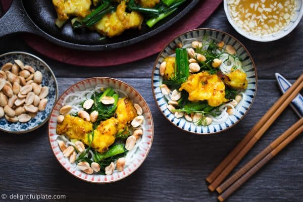 Vietnamese Turmeric Fish with Noodles (Cha Ca La Vong) is an iconic dish of Hanoi. It consists of flavorful fish, fresh herbs and serve with roasted peanuts and dipping sauce.