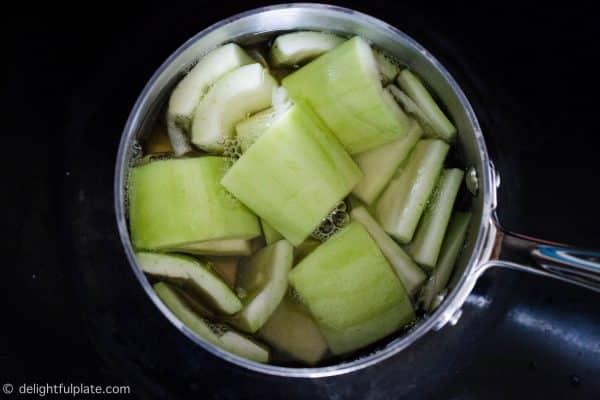 Boiling opo squash
