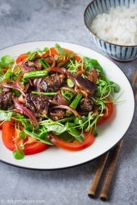 Vietnamese Shaking Beef (Bo Luc Lac) is an easy and delicious one-pan meal that is excellent for everyday meals as well as special occasions. This dish features tender and flavorful beef plated on a bed of green cress and fresh tomatoes.