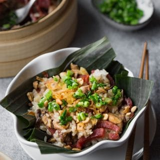 This flavorful steamed chicken sticky rice features soft-chewy sticky rice, chicken, shiitake mushrooms and sweet sausages (lap cheong). Everything is cooked together in a bamboo steamer and then served with popular toppings for savory sticky rice.