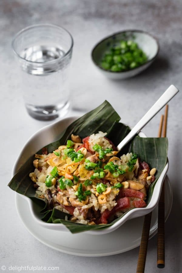 Steamed Chicken Sticky Rice with Chinese sausage, shiitake mushrooms and served with fried shallots, roasted peanuts and scallion oil.