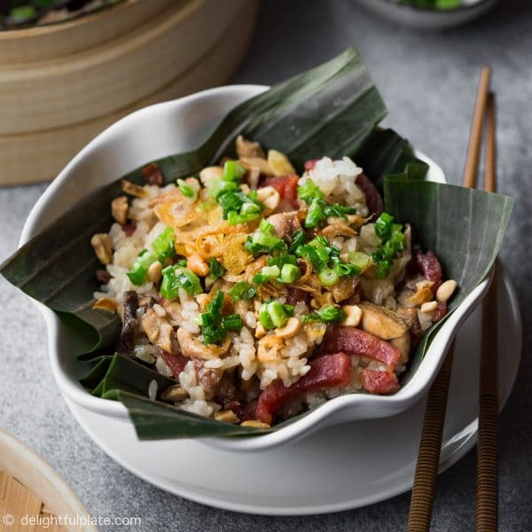 A delicious bowl of Vietnamese chicken sticky rice with Chinese sausage and shiitake mushrooms.