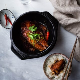 Vietnamese-style Caramelized Salmon is simmered with fish sauce and caramel sauce which gives it a delicious savory taste and beautiful color. Served with rice, this dish makes a very satisfying meal.