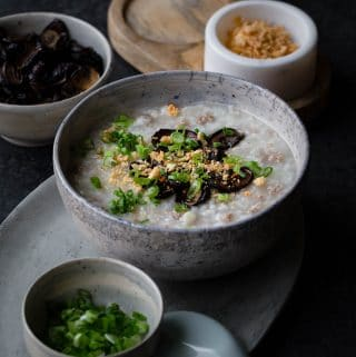 This Pressure Cooker Pork Congee with soy baked mushrooms is comforting and nourishing. Cooking the congee in a pressure cooker reduces time significantly while still achieving a creamy texture.