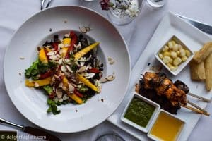 Salad and grilled skewers at Mango restaurant, St. Louis