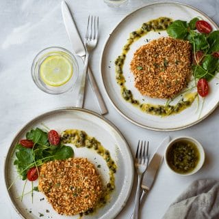 Crispy baked pork schnitzel that doesn't need to be deep-fried. It is healthy and much less messy to make. Serve it with a caper garlic butter sauce to increase the deliciousness.