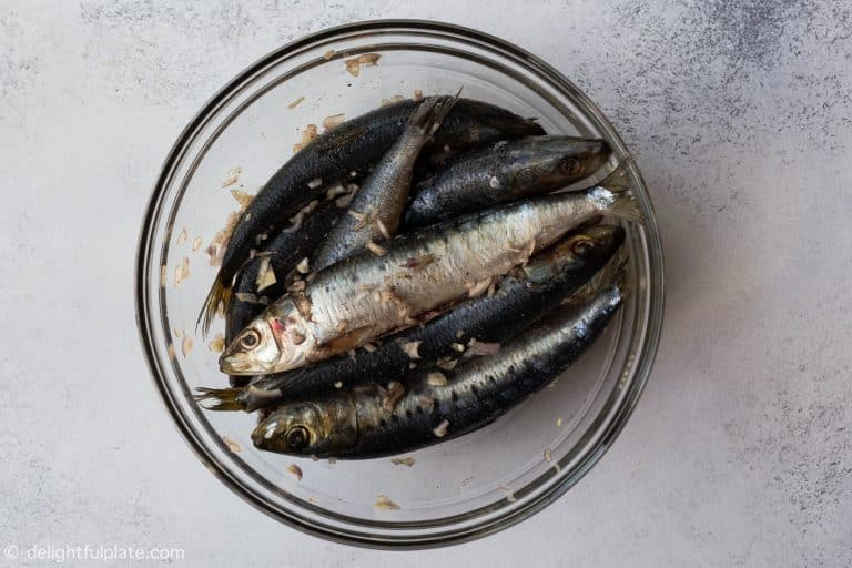 Sardines are marinated with shallots, garlic, salt and pepper before cooking.