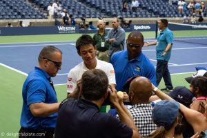 US Open 2018 - Nishikori signing autographs