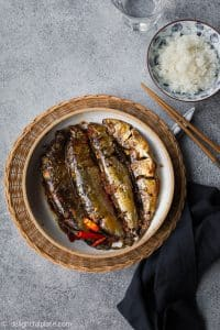 Vietnamese braised sardines with tomatoes and green tea are a delicious savory dish to eat with rice.