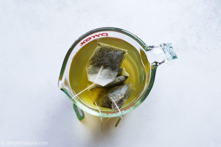 Brew green tea for passion fruit iced tea
