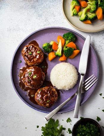 Japanese Hamburg Steak (Hambagu) features tender and juicy meatballs in a sweet tangy sauce. It is a delicious and easy dish for dinner or lunch box.