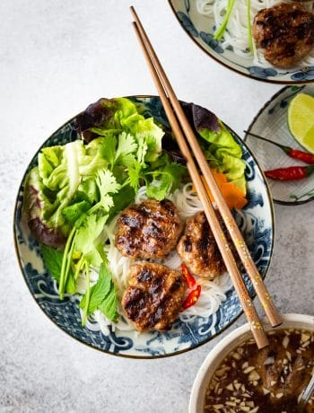 Vietnamese Grilled Pork Meatballs with Vermicelli Noodles (Bun Cha) is a classic Northern Vietnamese dish. Bun Cha features flavorful and juicy pork meatballs, vermicelli noodles, plenty of refreshing herbs and traditional lime fish sauce dipping.