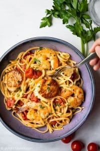 This scallop shrimp linguine with burst cherry tomatoes is perfect for not only quick and simple weeknight meals but also fancy date night dinners. It features tender chewy linguine, sweet and delicate scallops and shrimps and delicious sauce made from burst cherry tomatoes, garlic, butter and white wine.