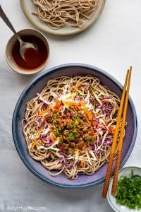 This Spicy Beef Soba Noodle Salad features beef, soba noodle, lots of fresh and crisp vegetables and a spicy gochujang dressing inspired by Korean flavors. It is not only quick and easy to make but also healthy and fulfilling.