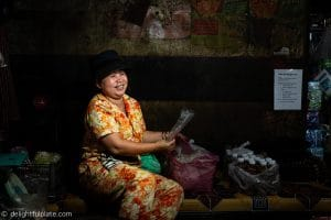 A smiling lady at a local market in Siem Reap