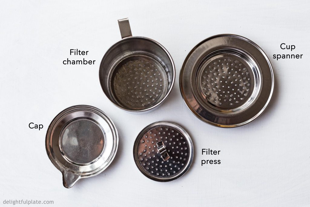 Components of Vietnamese phin filter, used to make Vietnamese coffee (cafe sua nong)