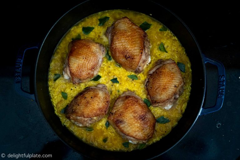 Cooking chicken and turmeric rice: put chicken on top of rice and put everything in the oven to bake