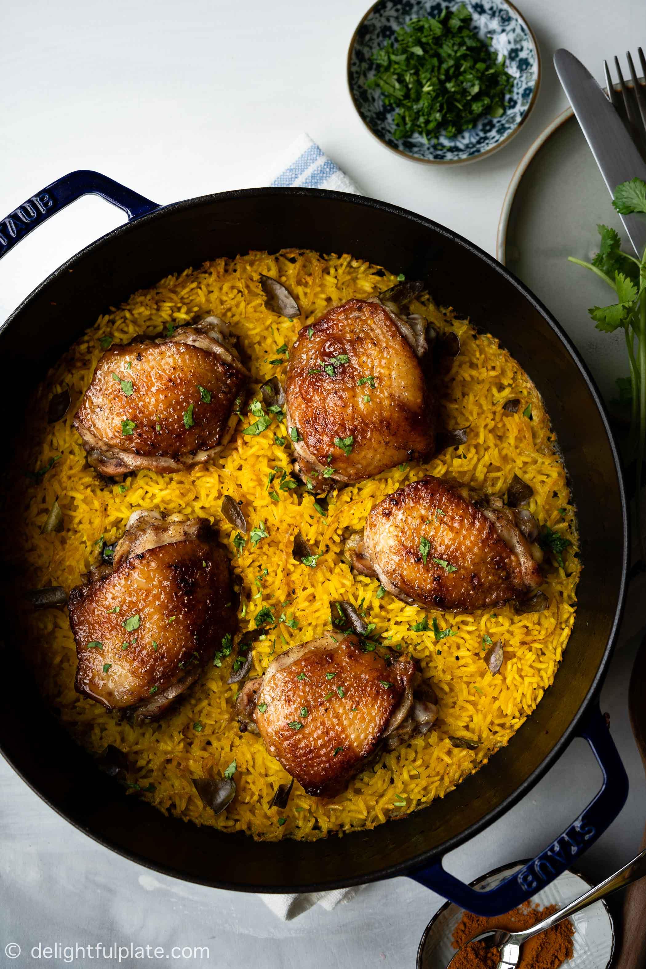 a pan of chicken turmeric rice