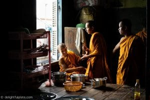 Young monks playing together in the pagoda's kitchen
