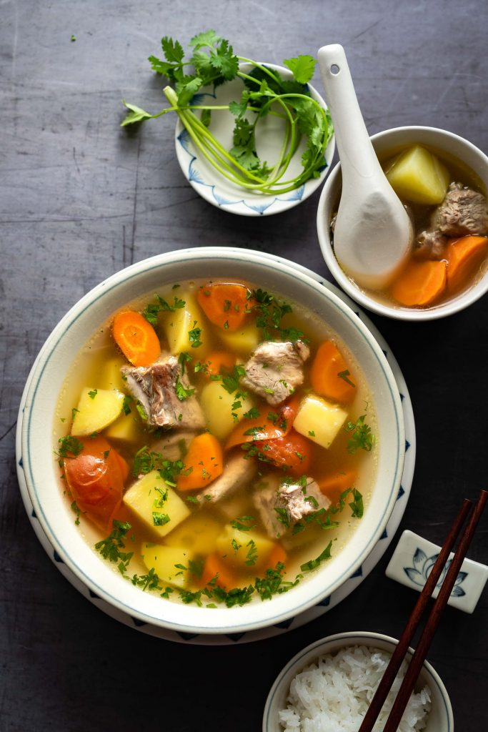 This Vietnamese Pork Rib Soup with Potatoes and Carrots (Canh Suon Khoai Tay Ca Rot) features tender pork ribs, potatoes, carrots with a clear and savory broth. Made with simple, easy to find and affordable ingredients, this soup is so comforting and fulfilling.