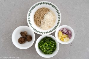 Rice, aromatics and herbs for chicken brown rice congee