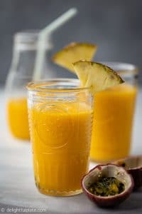 This Tropical Pineapple Mango Smoothie is a tasty and healthy drink with a pleasant sweet fruity scent. This thirst-quenching drink is also dairy-free with no added sugar.