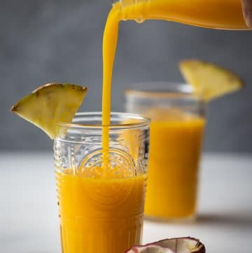 This Tropical Pineapple Mango Smoothie is a tasty and healthy drink with a pleasant sweet fruity scent. Made with fresh mango, pineapple, passion fruit and coconut juice, it is dairy-free with no added sugar.