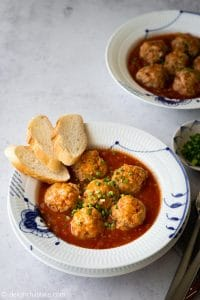 Vietnamese Pork Meatball Banh Mi (Banh Mi Xiu Mai) is a delicious Southern Vietnamese dish. Juicy pork meatballs in flavorful tomato sauce is served with crispy Vietnamese baguettes (banh mi). A quick and easy dish for any meals!