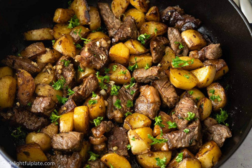 This Asian Steak Bites and Potatoes is an quick and easy one-pan weeknight dinner. It features beef cubes and tender potatoes with a buttery savory sauce.