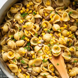 This delicious mushroom corn pasta features earthy mushrooms, charred corn, and a light cream sauce. It is a quick, easy and satisfying meatless pasta dish you can throw together in 30 minutes.