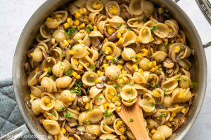 This vegetarian Mushroom Corn Pasta features mushrooms, sweetcorn and pasta in a cream sauce. An easy, delicious and fulfilling meatless meal that can be put together in 30 minutes.