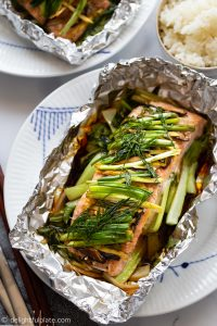 Moist and juicy salmon on a bed of crisp tender baby bok choy. Everything is cooked gently in foil packs and the fragrant steam when opening the salmon foil packet is amazing, thanks to ginger, garlic and dill.