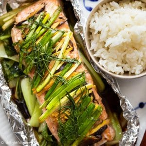 Asian Ginger Salmon in Foil with baby bok choy and aromatics and herbs.