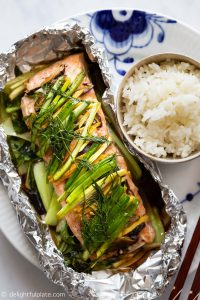 This Asian Ginger Salmon in Foil Packets is a healthy and delicious meal packed with juicy salmon, baby bok choy and herbs. Serve with steamed rice for a quick and easy weeknight dinner.