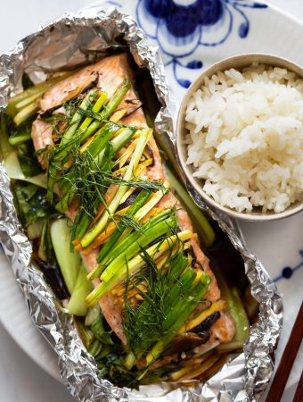 This Asian Ginger Salmon in Foil is a healthy and delicious meal packed with juicy salmon, baby bok choy and herbs. Serve with steamed rice for a quick and easy weeknight dinner.